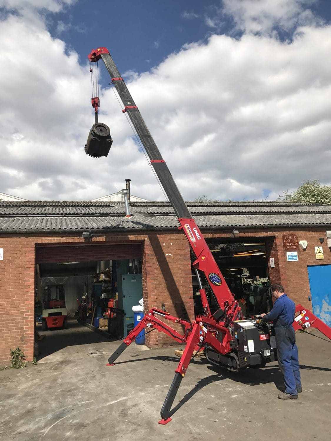 red spider crane hire in action, engineer on the control panel